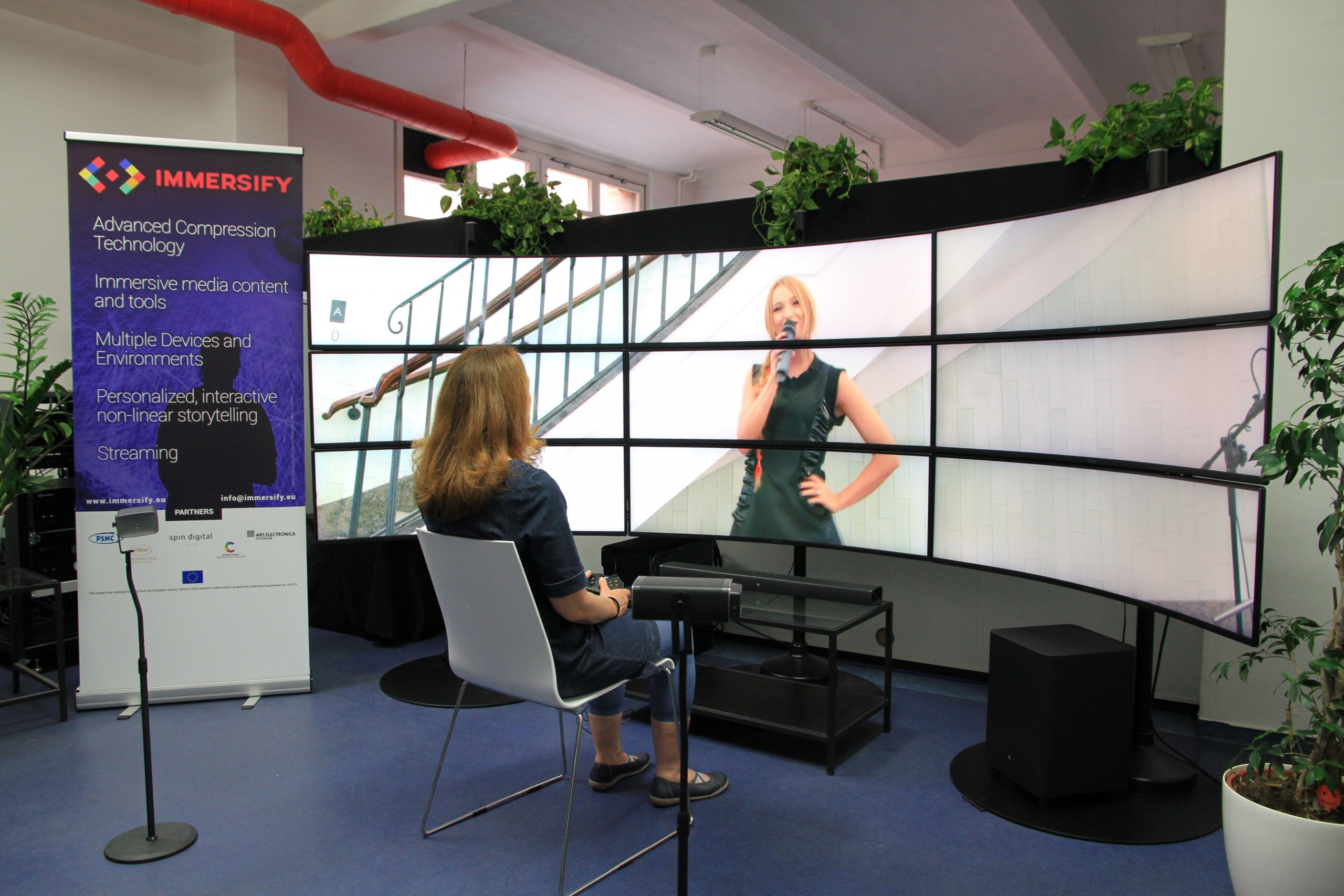 Demonstrating the immersive media player on a 12K curved display in the Spin Digital Lab. ©Spin Digital